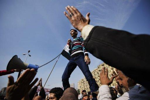 An Egyptian man delivers a speech as protesters gather in Cairo's landmark Tahrir Square to protest against a decree by President Mohamed Morsi granting himself broad powers that shield his decisions from judicial review