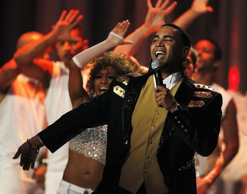 FILE - This April 26, 2012 file photo shows Don Omar performing during the Latin Billboard Awards in Coral Gables, Fla. Zumba Fitness instructors worldwide are not only using the Latin-heavy song lineup in their classes but creating new fans for artists such as Pitbull, Daddy Yankee and Don Omar, all of whom have recorded songs for Zumba. (AP Photo/Lynne Sladky, File)