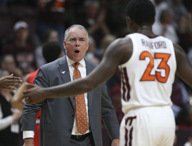 Virginia Tech head coach Mike Young, left, greets Tyrece Radford (23) after an offensive series in the first half of an NCAA college basketball game against Virginia Military Institute, Saturday, Dec. 21 2019, in Blacksburg, Va. (Matt Gentry/The Roanoke Times via AP)