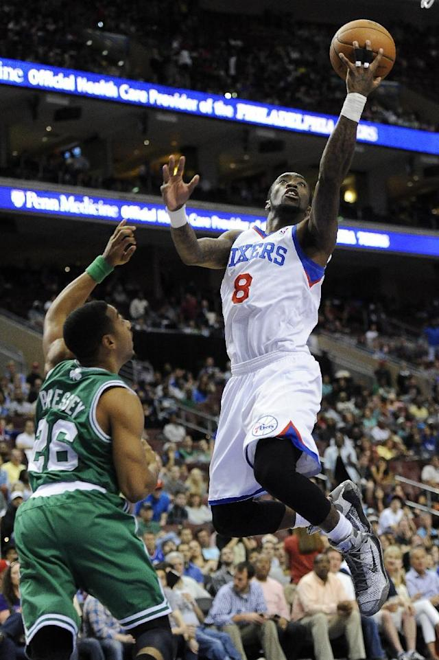 Philadelphia 76ers' Tony Wroten (8) drives to the basket past Boston Celtics' Phil Pressey during the second half of an NBA basketball game on Monday, April 14, 2014, in Philadelphia. The 76ers won 113-108. (AP Photo/Michael Perez)