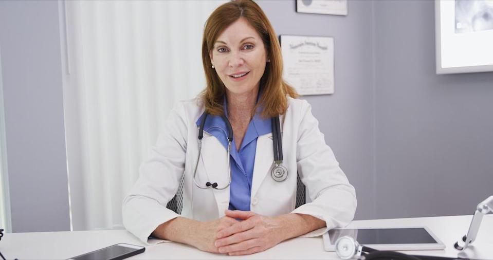professional physician talking to camera