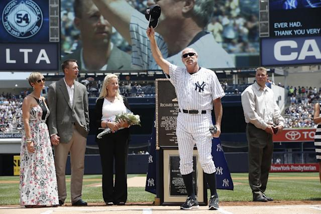 """Rich """"Goose"""" Gossage, stands with his family, during Old Timers Day ceremonies prior to the Baltimore Orioles baseball game against the New York Yankees at Yankee Stadium in New York, Sunday, June 22, 2014. A Monument Park plaque was dedicated in honor of Gossage. (AP Photo/Kathy Willens)"""