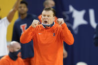 Illinois head coach Brad Underwood reacts to a play against Michigan in the second half of an NCAA college basketball game in Ann Arbor, Mich., Tuesday, March 2, 2021. (AP Photo/Paul Sancya)