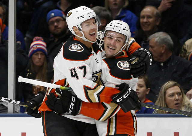 Anaheim Ducks center Sam Carrick (39) celebrates his short handed goal against the New York Islanders with teammate Hampus Lindholm (47) during the first period of an NHL hockey game, Saturday, Dec. 21, 2019, in Uniondale, N.Y. (AP Photo/Jim McIsaac)