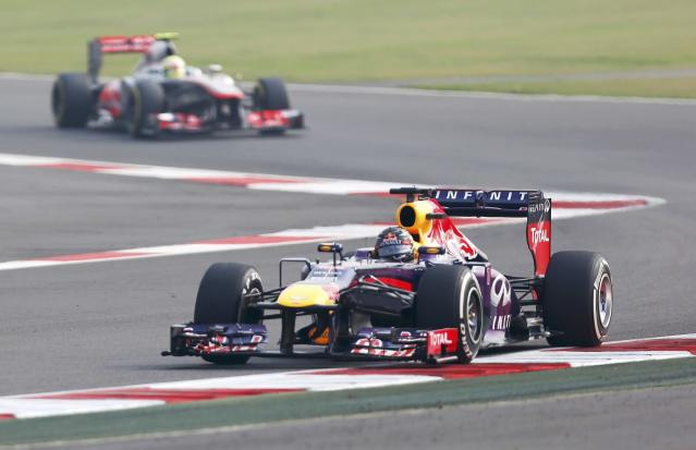 Red Bull Formula One driver Sebastian Vettel of Germany drives during the qualifying session of the Indian F1 Grand Prix at the Buddh International Circuit in Greater Noida, on the outskirts of New Delhi, October 26, 2013. REUTERS/Ahmad Masood (INDIA - Tags: SPORT MOTORSPORT F1)