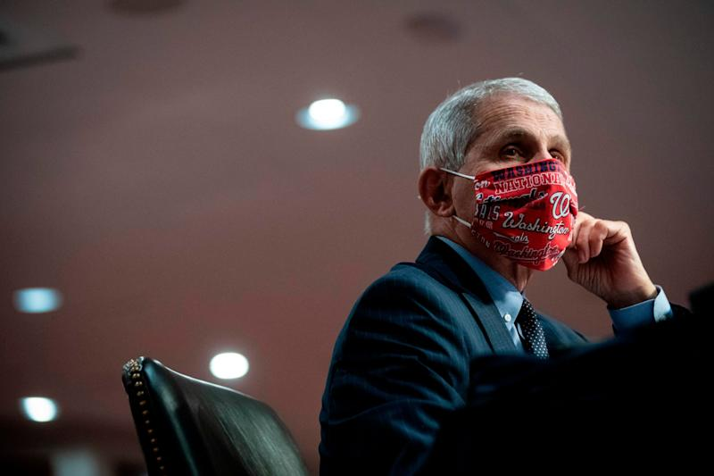 Anthony Fauci, director of the National Institute of Allergy and Infectious Diseases, wears a face covering during a Senate committee hearing in Washington, D.C., in June. (Photo: AL DRAGO via Getty Images)
