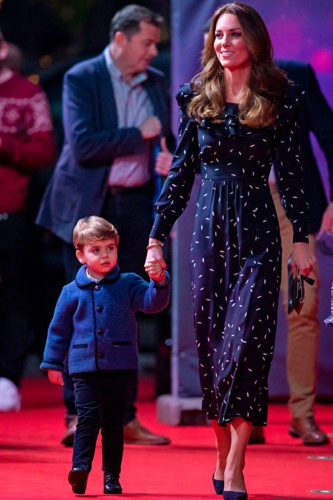 """<p>The Cambridges <a href=""""https://www.townandcountrymag.com/society/tradition/a34945223/prince-george-princess-charlotte-louis-london-palladium-appearance/"""" rel=""""nofollow noopener"""" target=""""_blank"""" data-ylk=""""slk:attended a special night at the theater"""" class=""""link rapid-noclick-resp"""">attended a special night at the theater</a>, where they saw a performance of the pantomime <em>Pantoland</em> at the London Palladium. Kate chose a navy and white patterned Alessandra Rich dress with navy pumps. She matched Prince Louis, who sported a blue jacket. </p><p><a class=""""link rapid-noclick-resp"""" href=""""https://go.redirectingat.com?id=74968X1596630&url=https%3A%2F%2Fwww.net-a-porter.com%2Fen-us%2Fshop%2Fdesigner%2Falessandra-rich&sref=https%3A%2F%2Fwww.townandcountrymag.com%2Fstyle%2Ffashion-trends%2Fnews%2Fg1633%2Fkate-middleton-fashion%2F"""" rel=""""nofollow noopener"""" target=""""_blank"""" data-ylk=""""slk:Shop Alessandra Rich"""">Shop Alessandra Rich</a></p>"""