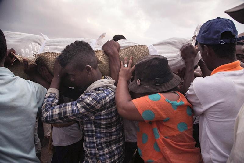 In Madagascar, a sacred ritual sees families exhume the remains of dead relatives, rewrap them in fresh cloth and dance with the corpses (AFP Photo/RIJASOLO)
