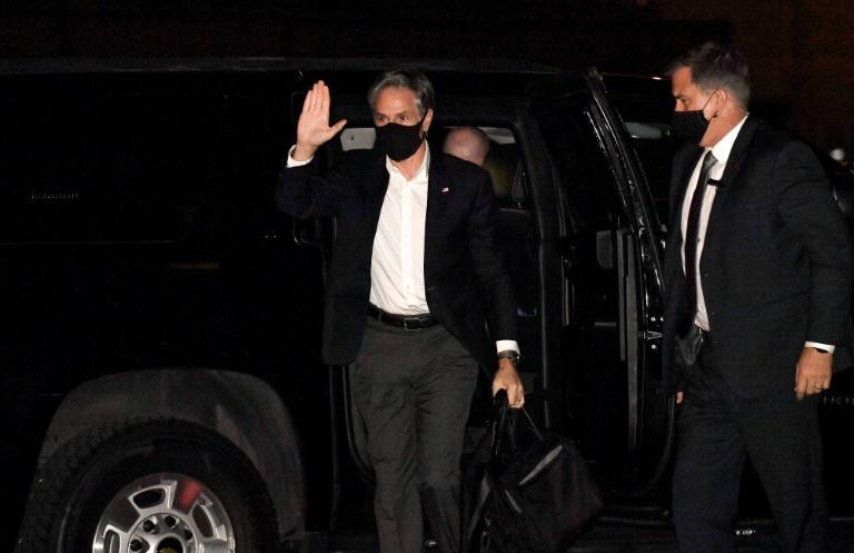 US Secretary of State Antony Blinken waves as he gets ready to board an aircraft from Joint Base Andrews in Maryland to travel to Doha (AFP/Olivier DOULIERY)