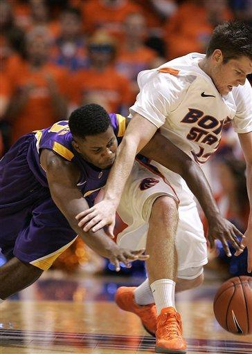 Boise State's Igor Hadziomerovic (12 and LSU's Shane Hammink (11) go after a loose ball during the first half of an NCAA college basketball game on Friday, Dec. 14, 2012 in Boise, Idaho. (AP Photo/Matt Cilley)