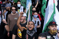 Demonstrators holding march to Israeli Consulate during a protest against Israel and in support of Palestinians, Saturday, May 15, 2021 in the Westwood section of Los Angeles. (AP Photo/Ringo H.W. Chiu)