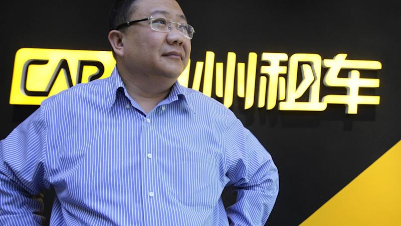 China's largest car rental agent halts trading in Hong Kong, as shares plunge amid scandal at chairman's associate company