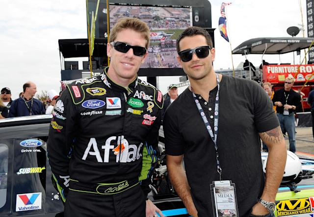 FORT WORTH, TX - NOVEMBER 06: Actor Jesse Metcalfe (R) poses with Carl Edwards (L), driver of the #99 Aflac Ford, on the grid prior to the NASCAR Sprint Cup Series AAA Texas 500 at Texas Motor Speedway on November 6, 2011 in Fort Worth, Texas. (Photo by John Harrelson/Getty Images for NASCAR)