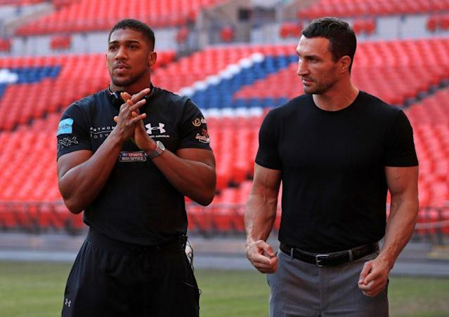 Anthony Joshua and Wladimir Klitschko during the press conference at Wembley Stadium, London. PRESS ASSOCIATION Photo. Picture date: Wednesday December 14, 2016. See PA story BOXING Wembley. Photo credit should read: John Walton/PA Wire