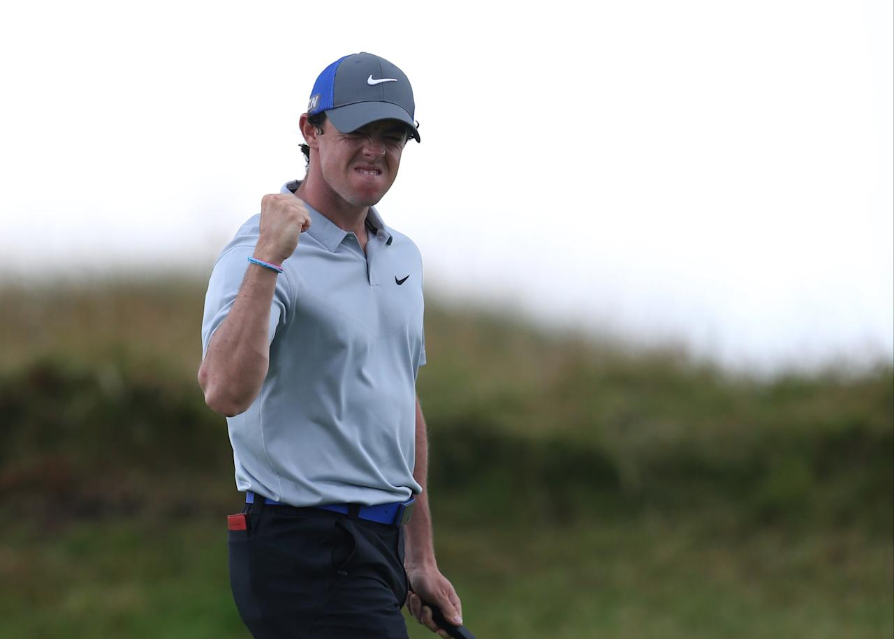 Rory McIlroy of Northern Ireland celebrates playing a birdie on the 14th hole during the third day of the British Open Golf championship at the Royal Liverpool golf club, Hoylake, England, Saturday July 19, 2014. (AP Photo/Jon Super)