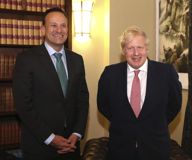 Ireland's Taoiseach Leo Varadkar, left, poses for a photo with Britain's Prime Minister, Boris Johnson, during their meeting at the Parliament Buildings, in Stormont, Belfast, Northern Ireland, Monday, Jan. 13, 2020. (Liam McBurney/PA via AP)