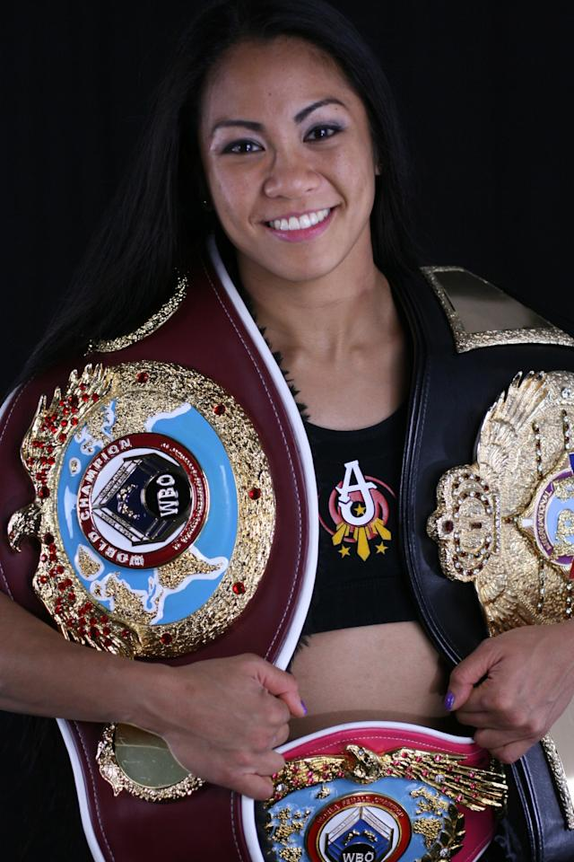 Bellator MMA flyweight Ana Julaton poses with her boxing title belts. (Courtesy AnaJulaton.com)
