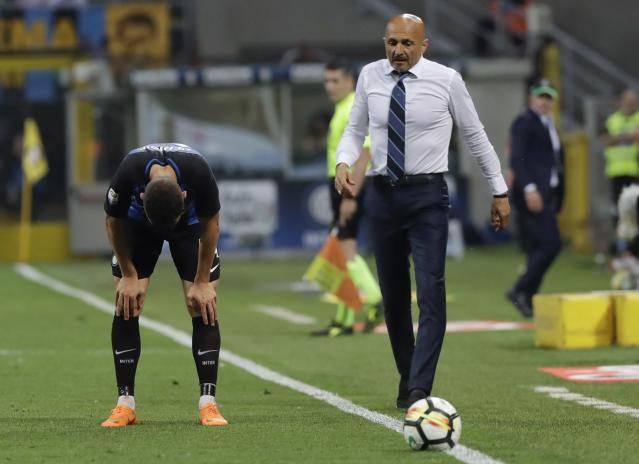 Inter Milan's Ivan Perisic, left, and coach Luciano Spalletti leave the pitch at the end of the Serie A soccer match between Inter Milan and Sassuolo at the San Siro stadium in Milan, Italy, Saturday, May 12, 2018. Sassuolo won 2-1. (AP Photo/Luca Bruno)