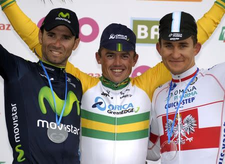 Orica-GreenEdge rider Simon Gerrans of Australia (C) celebrates on the podium after winning the Liege-Bastogne-Liege Classic cycling race, flanked by second-placed Movistar team rider Alejandro Valverde of Spain (L) and third-placed Omega Pharma-Quick Step rider Michal Kwiatkowski of Poland (R) in Ans, near Liege April 27, 2014. REUTERS/Laurent Dubrule (BELGIUM - Tags: SPORT CYCLING) - RTR3MTGF