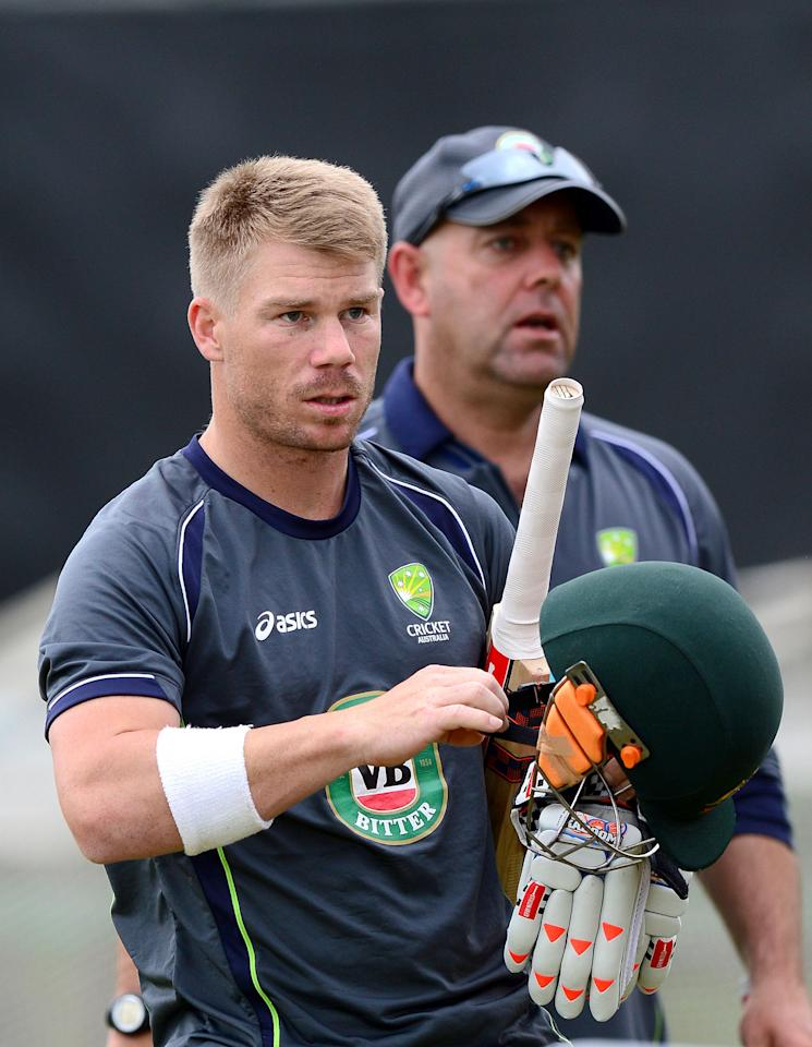 Australia's David Warner with coach Darren Lehmann (right) during the nets session at Old Trafford Cricket Ground, Manchester.