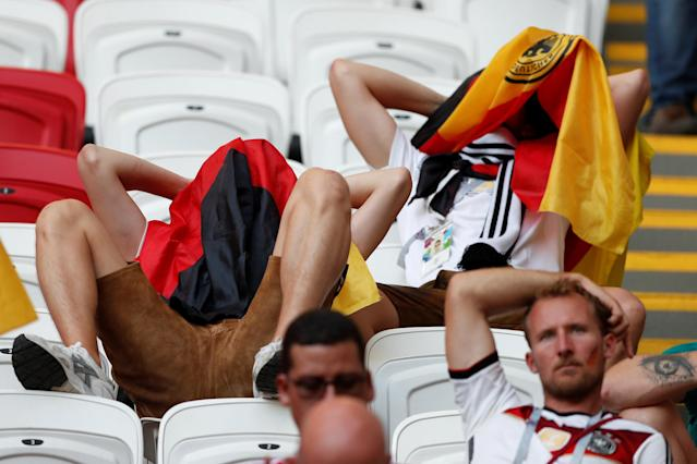 <p>Germany fans look dejected after the match as they go out of the World Cup. REUTERS/John Sibley </p>