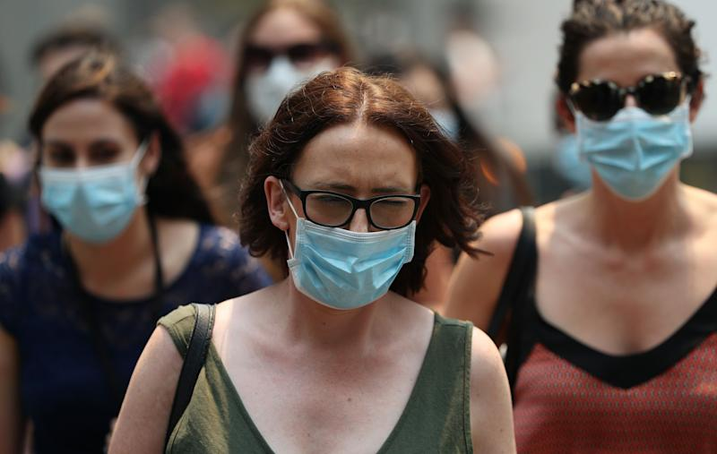 Some of the city's five million inhabitants have been forced to wear masks as the hazardous smoke envelopes the city. (Photo: Don Arnold via Getty Images)