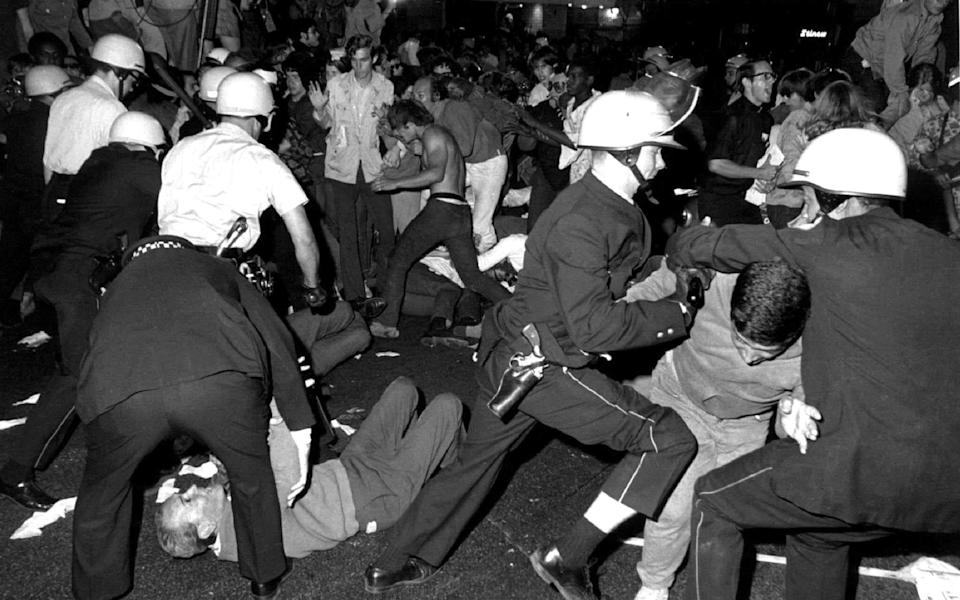 Police fight protesters on Michigan Avenue during the 1968 Democratic National Convention - Reuters