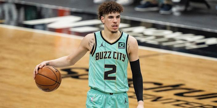 LaMelo Ball dribbles during a game.
