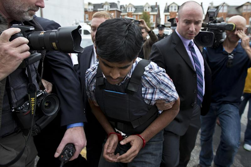 Raghunandan Yandamuri is escorted to a Montgomery County district court for an arraignment Friday, Oct. 26, 2012, in Bridgeport, Pa. Investigators said Yandamuri killed 10-month-old Saanvi Venna and her grandmother Satyavathi Venna in a botched ransom kidnapping. He is being held without bail on murder, kidnapping and other charges. (AP Photo/Matt Rourke)