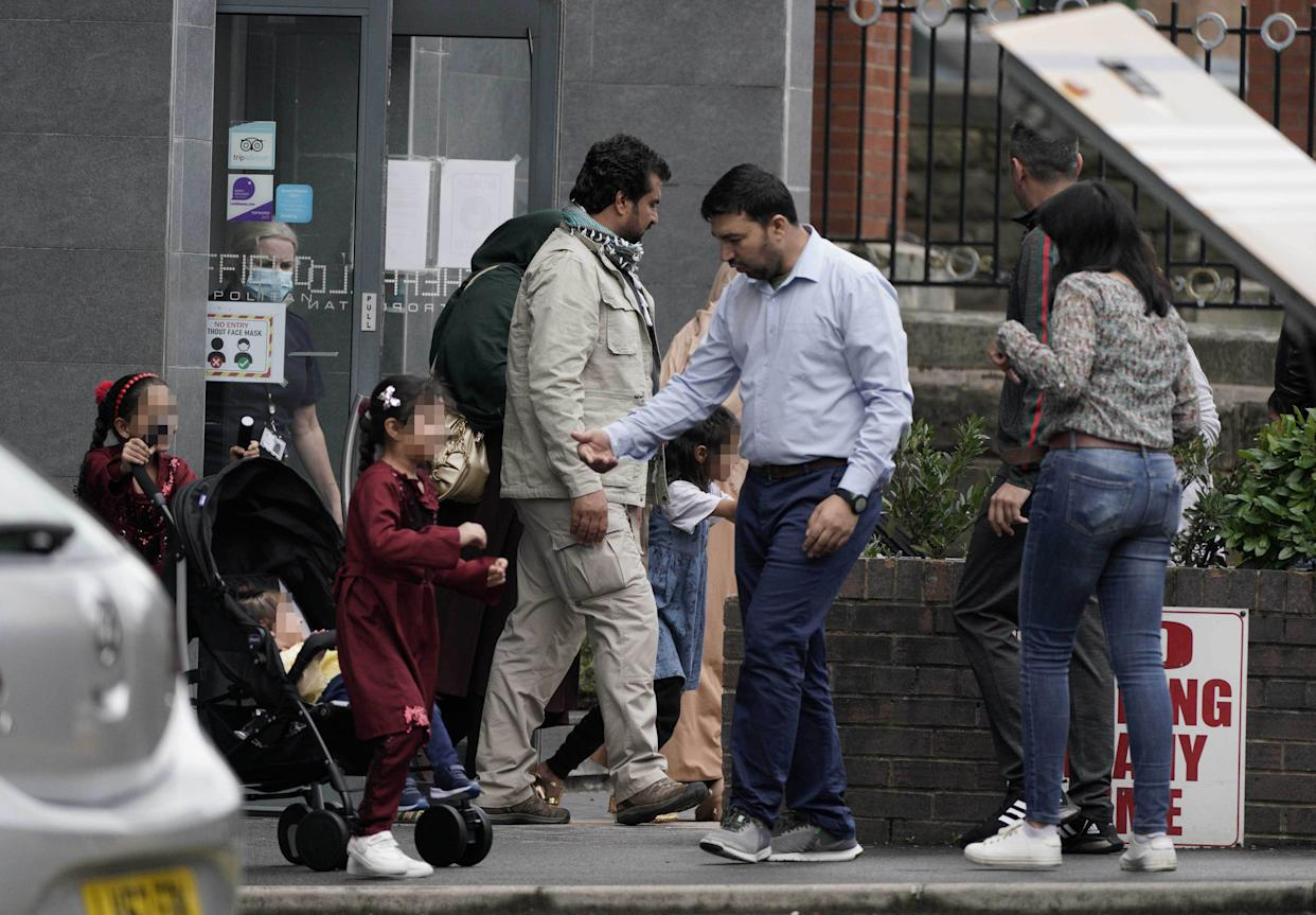 People leave the Sheffield Metropolitan Hotel in Blonk Street, where a five year old boy, an Afghan refugee whose family recently fled the Taliban, died after he fell from a window on Wednesday.