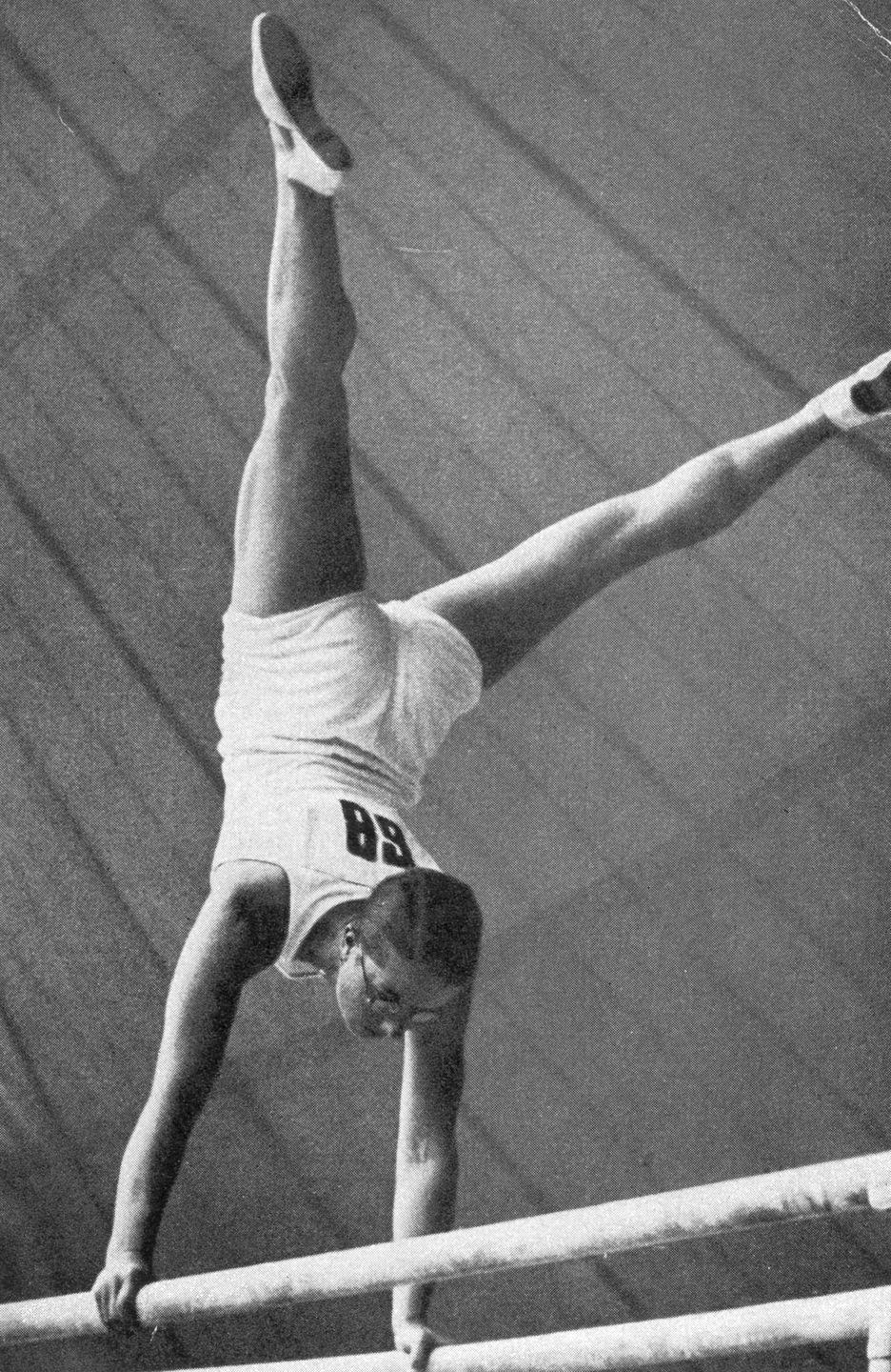 <p>Female gymnast Käthe Sohnemann is seen here competing on the parallel bars (yes, women used to compete on different apparatus'!) and she won bronze in the all-around. </p>