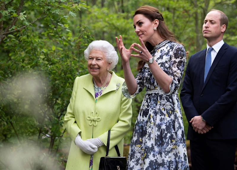 Britain's Catherine, Duchess of Cambridge (C) shows Britain's Queen Elizabeth II (L) and Britain's Prince William, Duke of Cambridge, around the 'Back to Nature Garden' garden, that she designed along with Andree Davies and Adam White, during their visit to the 2019 RHS Chelsea Flower Show in London on May 20, 2019. - The Chelsea flower show is held annually in the grounds of the Royal Hospital Chelsea. (Photo by Geoff Pugh / POOL / AFP) (Photo credit should read GEOFF PUGH/AFP/Getty Images)