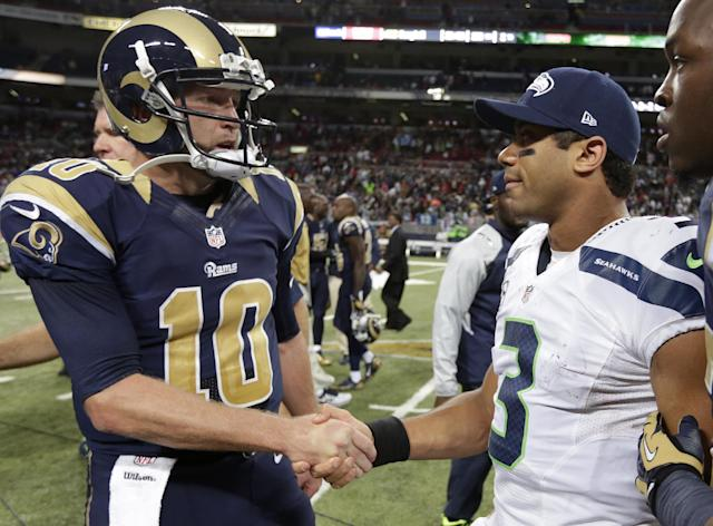 St. Louis Rams quarterback Kellen Clemens (10) shakes hand with Seattle Seahawks quarterback Russell Wilson (3) after an NFL football game, Monday, Oct. 28, 2013, in St. Louis. The Seahawks won 14-9. (AP Photo/Michael Conroy)
