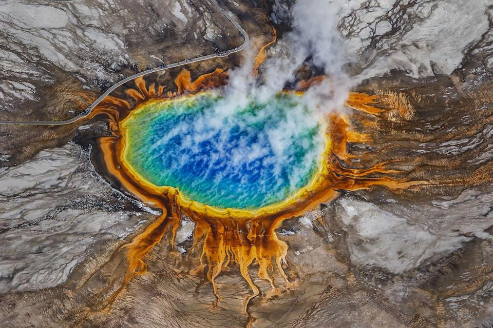 <p>Discovered in the 19th century at Yellowstone National Park, the Grand Prismatic Spring is the largest and possibly the most colorful hot spring in United States. Each vibrant ring of the hot spring contains a different type of thermophile, or microorganism. The thermophiles react in different ways to the exposure of ultraviolet light from the sun, producing the various shades with the water. </p>