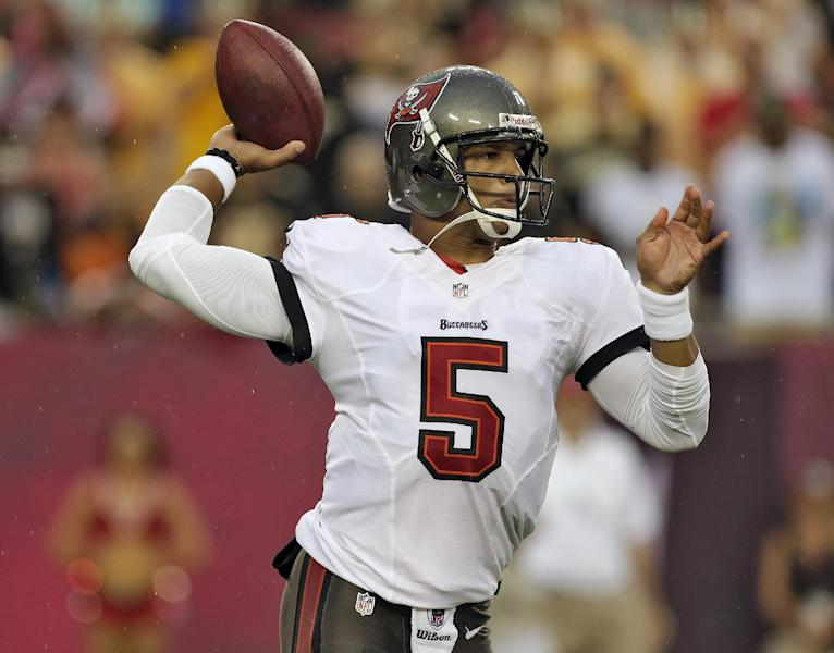 FILe - In this Sept. 15, 2013 file photo, Tampa Bay Buccaneers quarterback Josh Freeman (5) throws a pass against the New Orleans Saints during the first quarter of an NFL football game in Tampa, Fla. The Buccaneers have released Freeman, Thursday, Oct. 3. 2013, one week after benching the fifth-year pro in favor of rookie Mike Glennon. (AP Photo/Chris O'Meara, File)