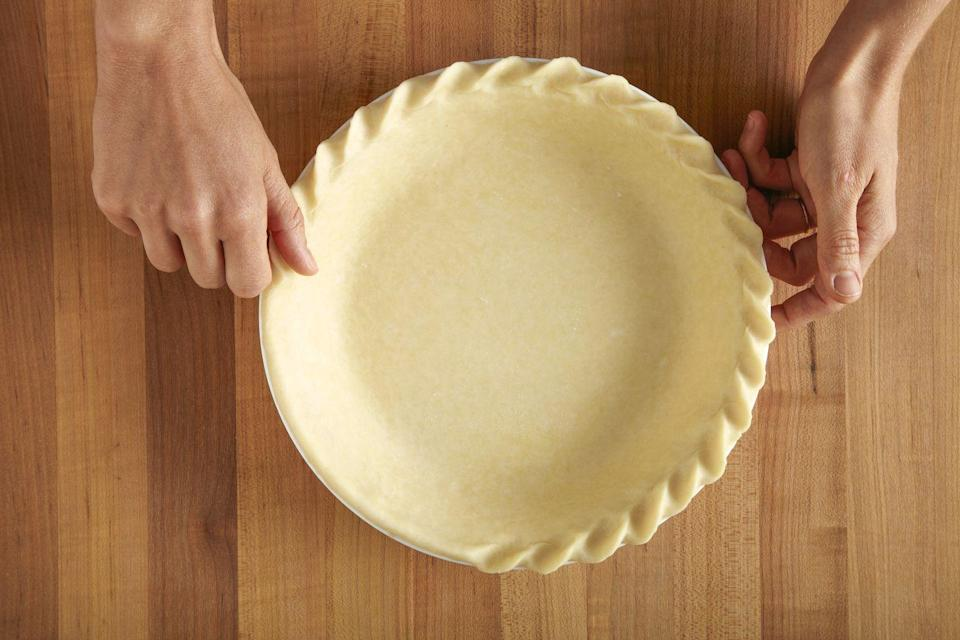 <p>Turn a simple pinch into a twisted, rope-like look by squeezing the pie dough on an angle between your thumb and index finger, slightly pushing the bent finger in while pulling back with your thumb.</p>