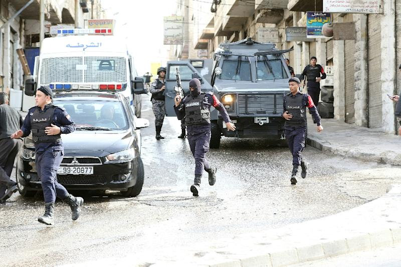 Jordanian security forces securing a street in the town of Irbid, near the border with Syria, on March 2, 2016 (AFP Photo/Khalil Mazraawi)