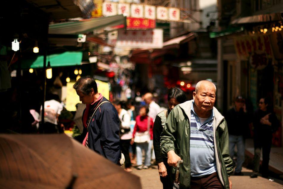 Shoppers walk in a Hong Kong street.