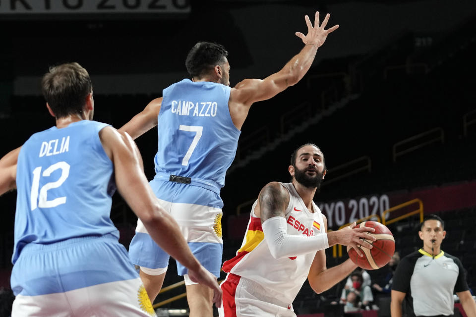 Spain's Ricky Rubio, right, shoots in front of Argentina's Facundo Campazzo (7) during a men's basketball preliminary round game at the 2020 Summer Olympics, Thursday, July 29, 2021, in Saitama, Japan. (AP Photo/Eric Gay)