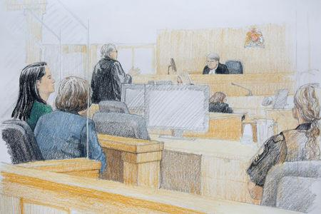 Huawei CFO Meng Wanzhou (L), who was arrested on an extradition warrant, appears at her B.C. Supreme Court bail hearing in a drawing in Vancouver, British Columbia, Canada December 7, 2018.  REUTERS/Jane Wolsak