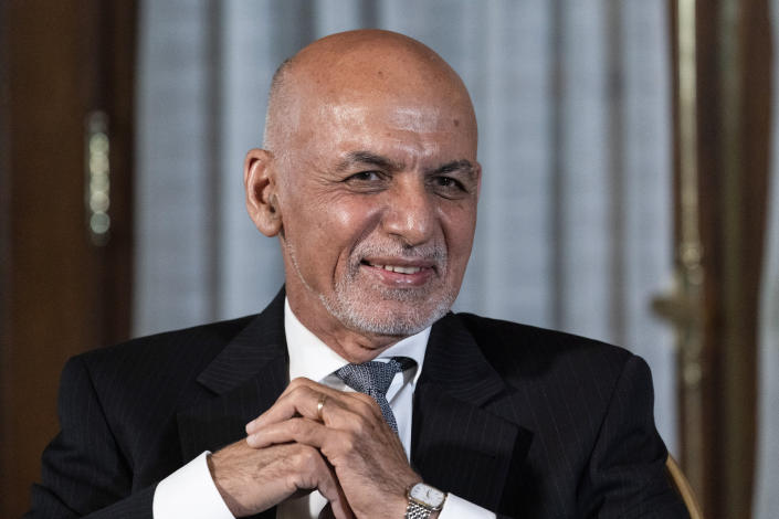 FILE In this June 25, 2021 file photo, Afghan President Ashraf Ghani is seated after his meeting with President Joe Biden in Washington. In an interview with The Associated Press Thursday, July 22, 2021, Suhail Shaheen, Afghan Taliban spokesman and a member of the Taliban negotiation team, said the insurgent movement does not want to monopolize power, but there won't be peace until there is a new, negotiated government in Kabul and Ghani is removed. Shaheen said women will be allowed to work, go to school, and participate in politics but will have to wear the hijab, or headscarf. (AP Photo/Alex Brandon, File)