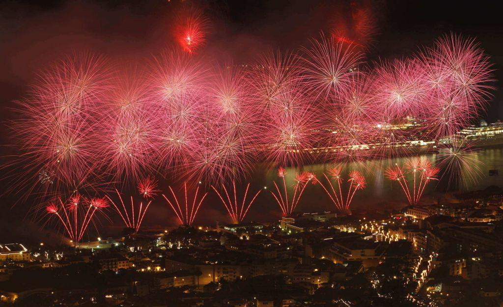 Fireworks explode over the Funchal city bay during New Year celebrations in Madeira island January 1, 2013.