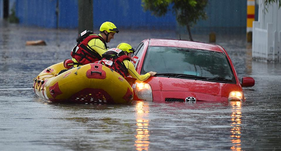 A Swift Water Rescue team from the Queensland Fire and Emergency Services are seen searching flooded cars on Longlands Street at Woolloongabba in Brisbane, Tuesday, October 27, 2020. Southeast Queensland has been affected by multiple severe thunderstorms and torrential rain. (AAP Image/Darren England) NO ARCHIVING