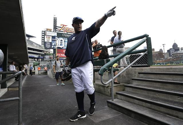 Detroit Tigers' Miguel Cabrera points to a fan during warmups before a baseball game against the Minnesota Twins in Detroit, Wednesday, Aug. 21, 2013. (AP Photo/Paul Sancya)