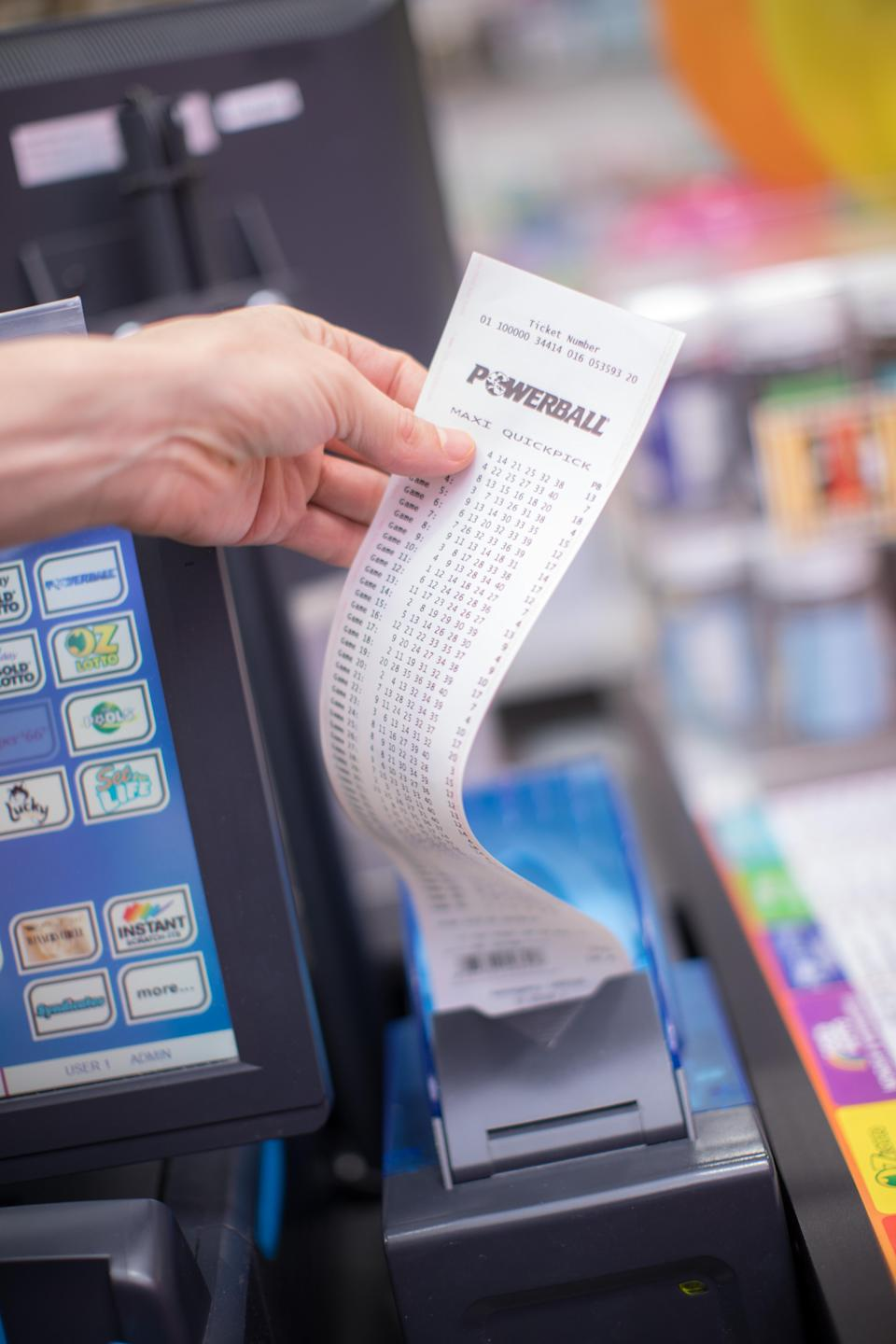 Photo shows Powerball ticket being printed out at a newsagency. Source: The Lott