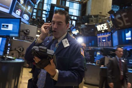Traders work on the floor of the New York Stock Exchange June 24, 2014. REUTERS/Brendan McDermid