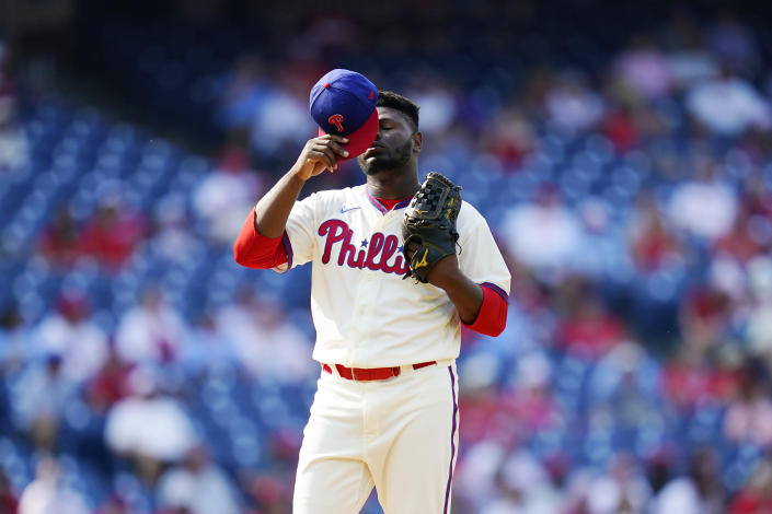 Philadelphia Phillies pitcher Hector Neris reacts after giving up a two-run home run to Colorado Rockies' Garrett Hampson during the seventh inning of a baseball game, Sunday, Sept. 12, 2021, in Philadelphia. (AP Photo/Matt Slocum)