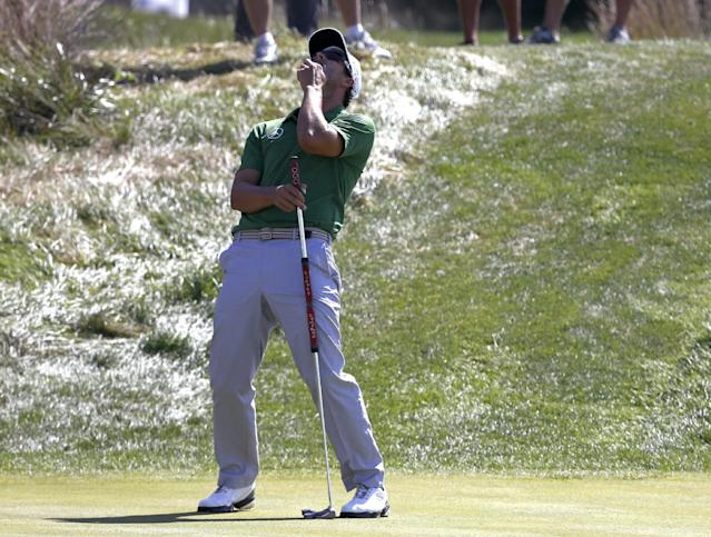 Adam Scott reacts after missing a birdie attempt on the 11th green during the first round of the BMW Championship golf tournament at Conway Farms Golf Club in Lake Forest, Ill., Thursday, Sept. 12, 2013. (AP Photo/Charles Rex Arbogast)