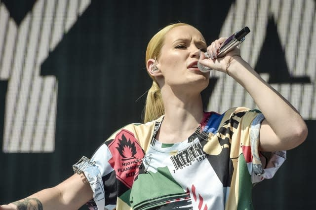 Iggy Azalea vows to press charges after topless pictures leak
