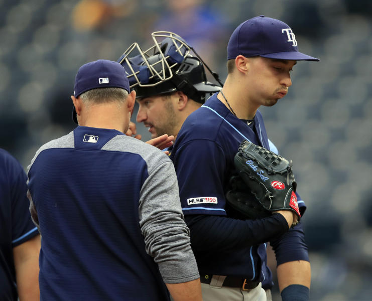 "FILE - In this May 1, 2019, file photo, Tampa Bay Rays starting pitcher Blake Snell, right, is taken out by manager Kevin Cash, left, during the fourth inning of a baseball game against the Kansas City Royals at Kauffman Stadium in Kansas City, Mo. Rays All-Star pitcher Blake Snell says he  will not take the mound this year if his pay is cut further, proclaiming: ""I'm not playing unless I get mine."" the 2018 AL Cy Young Award winner said on a Twitch stream Wednesday, May 14 2020. (AP Photo/Orlin Wagner, File)"